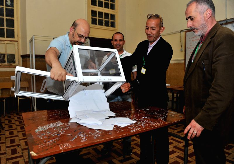 ALGIERS, May 4, 2017 - Scrutineers count ballots at a polling station in Algiers, Algeria on May 4, 2017. Algeria's new lower house parliamentary elections kicked off on Thursday to choose its 462 ...