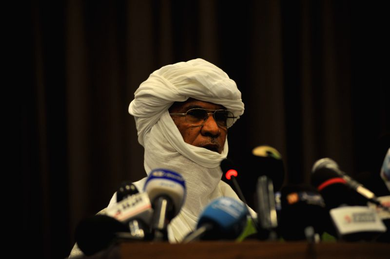 A Malian rebel representative speaks during the opening of peace talks between the Malian government and armed rebels, which are the second round of negotiations ...
