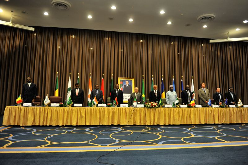 Malian government officials attend the opening of peace talks between the Malian government and armed rebels, which are the second round of negotiations since July .