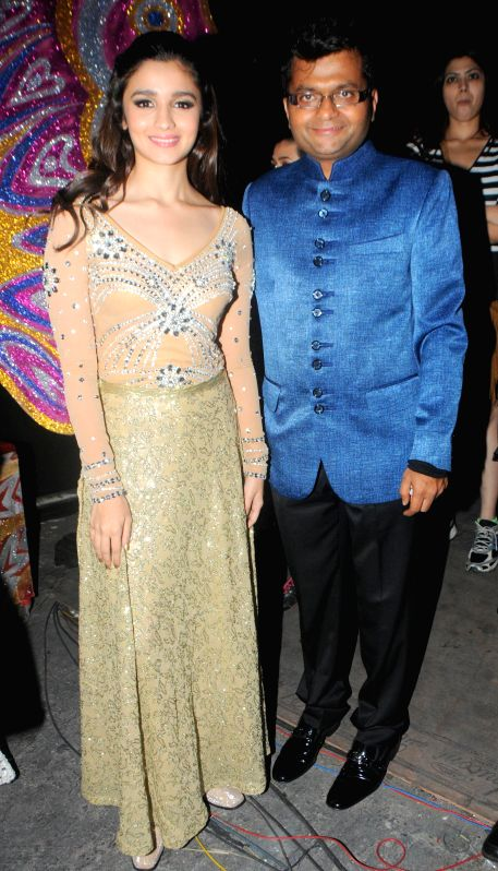 Alia Bhatt with Aneel Murarka during the International Indian Achiever`s Award 2014 presented by YES BANK in Mumbai on July 28, 2014.