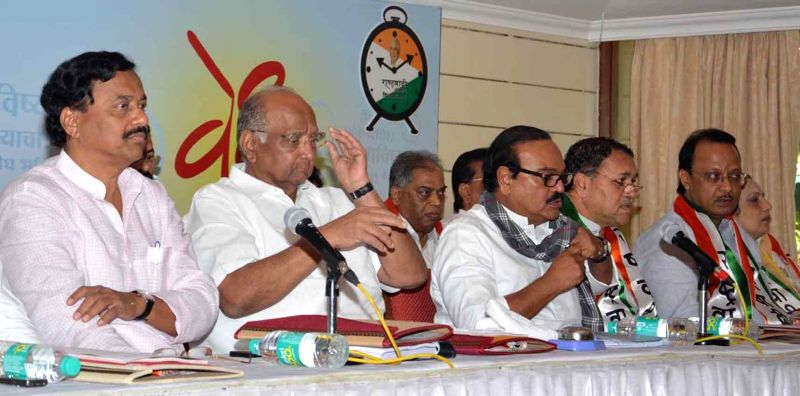 NCP chief Sharad Pawar addresses during a party programme in Alibag of Maharashtra in Mumbai, on Nov 18, 2014.Also seen NCP leaders Sunil Tatkare, Praful Patel, Chhagan Bhujbal, Ajit Pawar  .. - Praful Patel