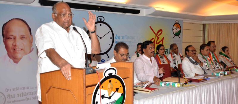 NCP chief Sharad Pawar addresses during a party programme in Alibag of Maharashtra in Mumbai, on Nov 18, 2014.Also seen NCP leaders Sunil Tatkare, Chhagan Bhujbal, Ajit Pawar  and others.