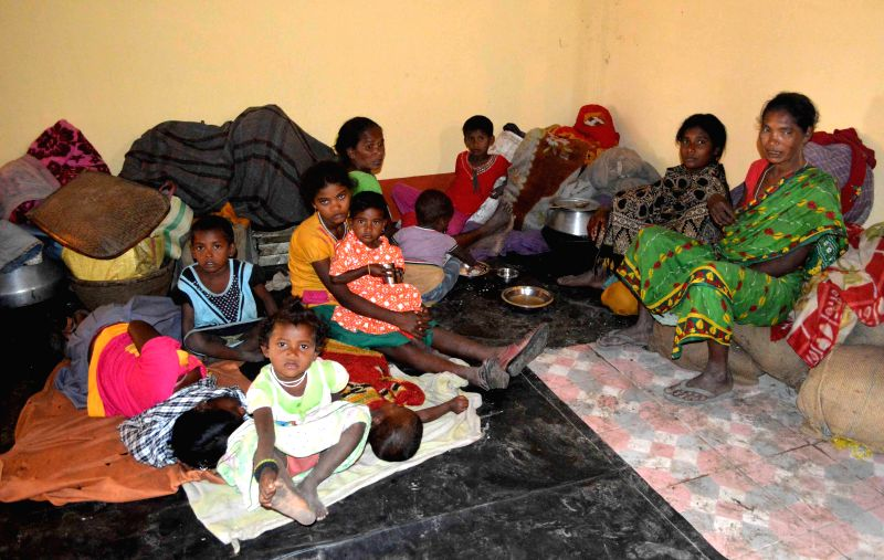 Assam refugees take shelter in Alipurduar after fleeing from their villages in Assam on Dec 26, 2014.