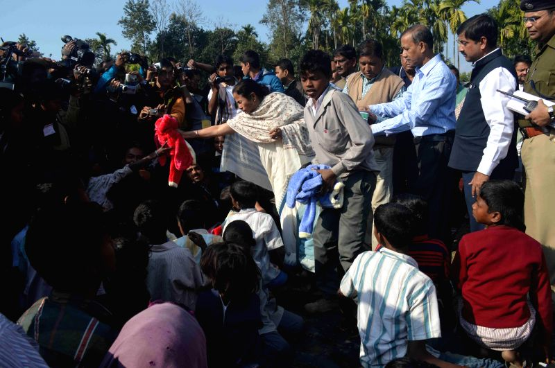 West Bengal Chief Minister Mamata Banerjee distribute winter clothes to refugees at Kumargram in Alipurduar, West Bengal, on Dec 27, 2014.