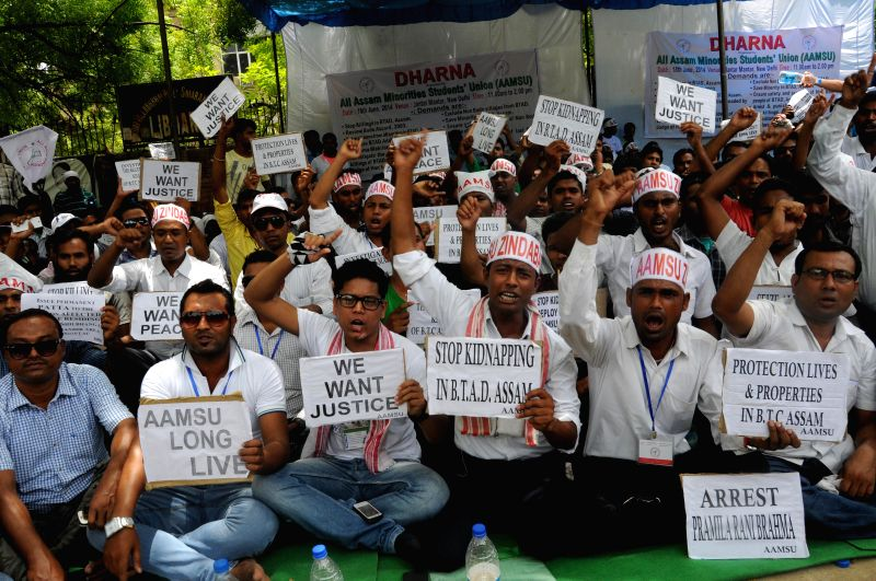 All Assam Minorities Students Union (AAMSU) members during a demonstration against Assam government at Jantar Mantar in New Delhi on June 18, 2014.