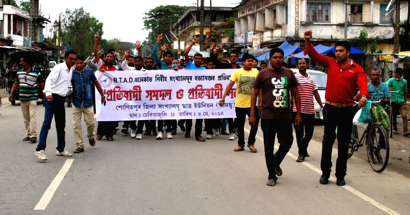 All Assam Minority Student's Union activists participate in a protest rally against recent violence in BTAD area at Dhekiajuli in Assam's Sonitpur district on May 4, 2014.