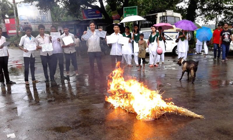 All Assam Student's Union (AASU) activists burn an effigy of Assam Chief Minister Tarun Gogoi during a demonstration  to protest against the recent killings near Assam-Nagaland border  in ... - Tarun Gogoi
