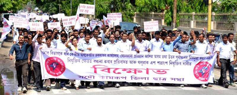 All Assam Students' Union (AASU)  activists participate in a rally to demand 100 per cent reservation for locals in Government, Semi government and Private sectors in Guwahati on May 12, 2014.