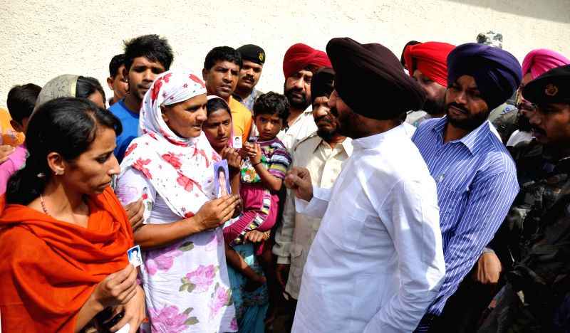 All India Anti Terrorist Front Chairman M S Bitta interacts with family members of Indians who are trapped in violence-hit Iraq in Amritsar on June 26, 2014.