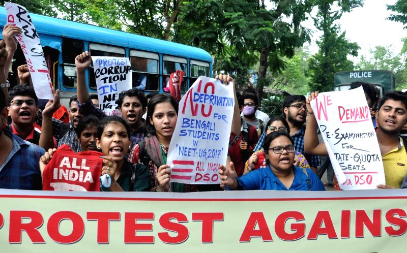 All India Democratic Students' Organisation (AIDSO) activists stage a demonstration against Union Government at Swasthya Bhawan in Kolkata on May 15, 2017.