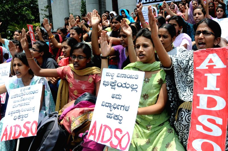 All India Democratic Students' Organization (AIDSO) activists demonstrate against hike in examination fees of Bangalore University in Bangalore on April 24, 2014.