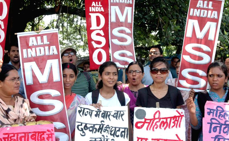 All India DSO activists demonstrate against crime against women in Patna on July 18, 2014.