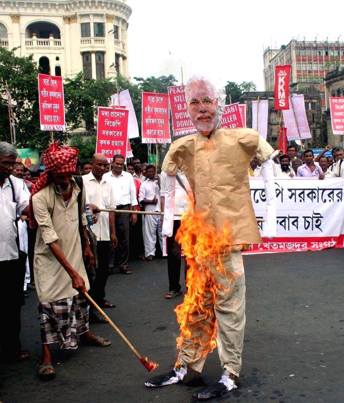 AIKMU protest against PM Modi - Narendra Modi