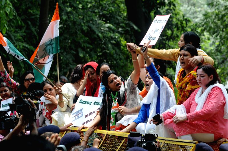 All India Mahila Congress workers demonstrate in New Delhi on June 18, 2014.