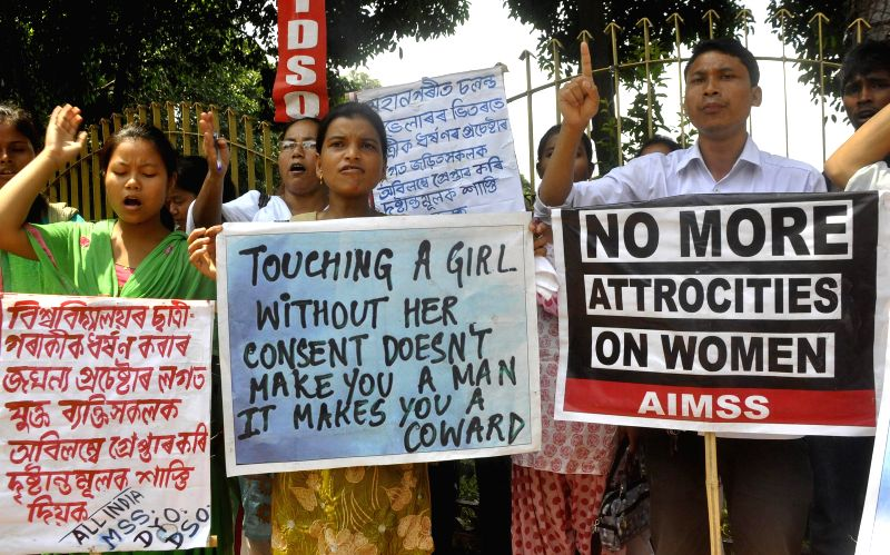 All India Mahila Samskritik Sanghatan (AIMSS) activists protest against aleged molestation of a Gauhati University student in a moving public vehicle near Assam chief minister's residence in Guwahati