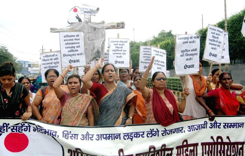 All India Progressive Women Association activists demonstrate against BJP's National Kisan Morcha president, OP Dhankar's remarks on Bihari women in Patna on July 7, 2014.
