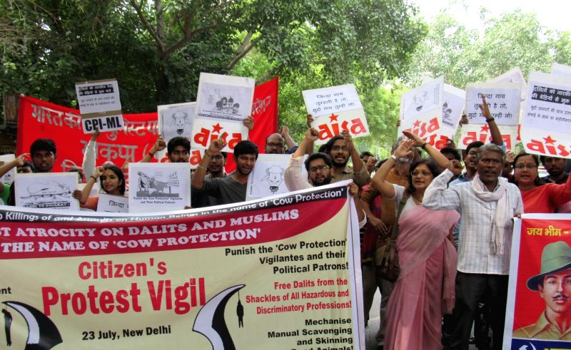 """All India Student Union (AISA) activists staged a protest against atrocity on Dalits and Muslims in the name of """"Cow Protection"""" in New Delhi, on July 23, 2016."""