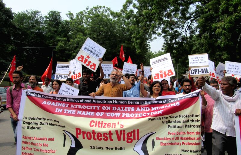 "All India Student Union (AISA) activists staged a protest against atrocity on Dalits and Muslims in the name of ""Cow Protection"" in New Delhi, on July 23, 2016."
