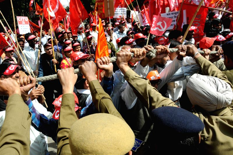 All India Trade Union Congress (AITUC) activists stage a demonstration near the Parliament against Narendra Modi led central government for its anti labour policies in New Delhi, on Feb 26, 2015. - Narendra Modi