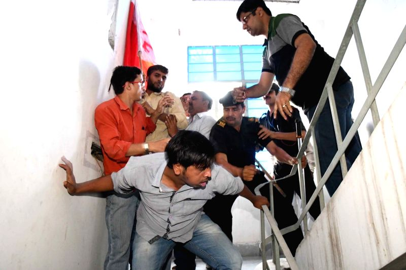 All India Youth Federation (AIYF) members clash with security personnel during protest against the cancellation of registrations in BA part first in Magadha University in Patna on April 28, ...