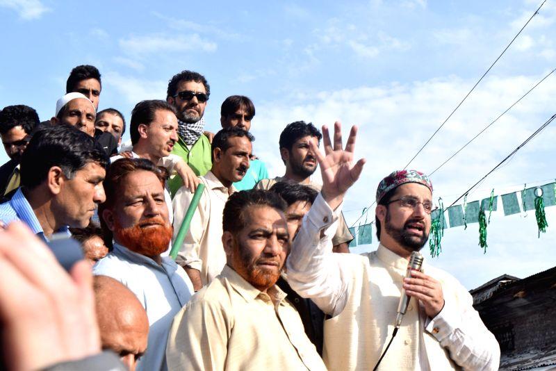 All Parties Hurriyat Conference (M) Chairman Mirwaiz Umar Farooq addresses a public rally in Srinagar on June 19, 2014.