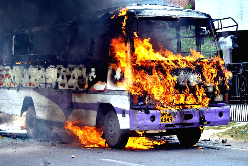 A bus that was set ablaze by a group of irate candidates appearing in UP Provincial Civil Services preliminary examination after the first paper of the exams were leaked on  social media, ...