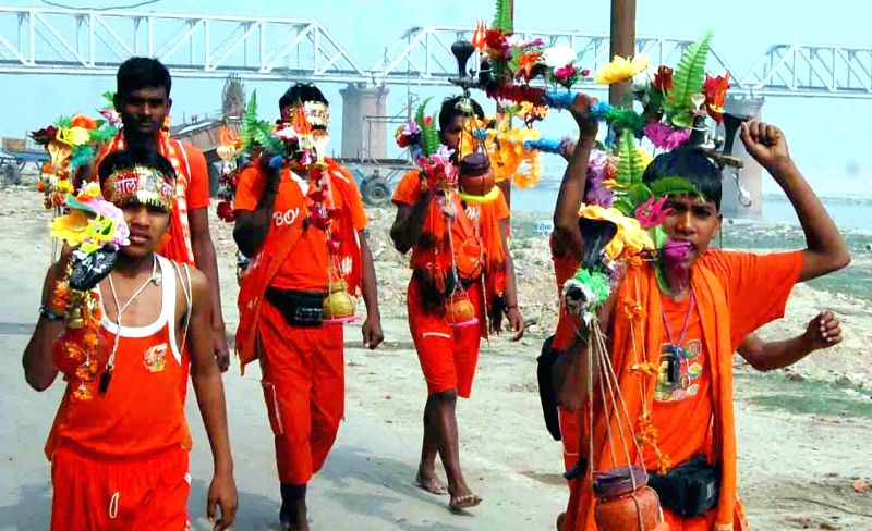 A group of kanwariyas arrived on the banks of Ganga to take holy water on the eve of the Maha Shivaratri in Allahabad in on Feb. 16, 2015.