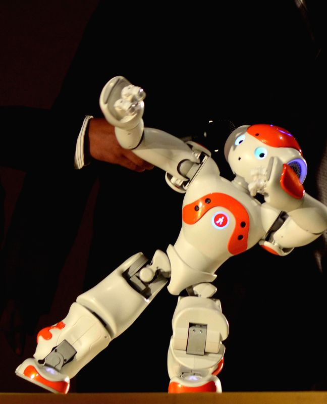 A robot made by the students of the Indian Institute of Information Technology, Allahabad dances at the campus of the institution on Dec 10, 2014.