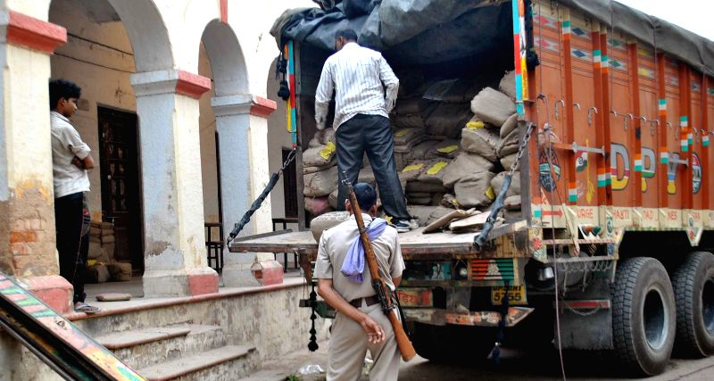 A truck load of answer-scripts of Uttar Pradesh Board exams arrive at an evaluation centre in Allahabad on March 30, 2015.