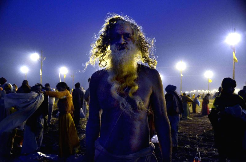 An ascetic  at Sangam in Allahabad as a month long Magh mela commences on Jan 5, 2015.