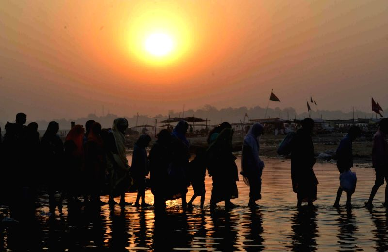 Devotees arrive at the Sangam to take a holy dip on Buddha Purnima in Allahabad, on May 4, 2015.