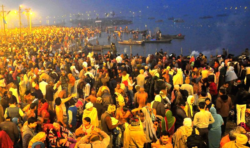 Devotees gather at the Sangam - the confluence of the Ganga, the Yamuna and the Saraswati (mythical) rivers on Mauni Amavasya in Allahabad, on Jan 20, 2015.