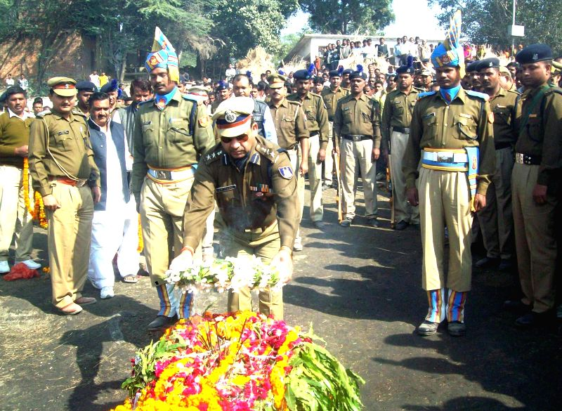 Funeral of CRPF jawan Mukesh, who was among the 13 CRPF soldiers killed in Dec 1 gun battle with Maoists in Chhattisgarh, at Shringverpur ghat on the banks of Ganga, in Allahabad on Dec 3,