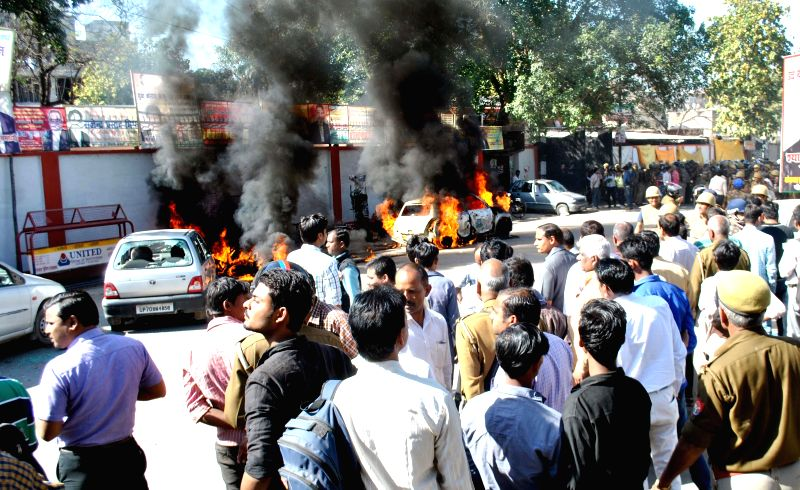 Irate lawyers torch vehicles in Allahabad after a police official shot dead a lawyer and injured another outside the Allahabad High Court on March 11, 2015.