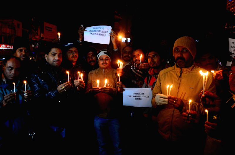 Journalists protest against the massacre of 12 people at the office of a French satirical magazine in Paris, in Allahabad, on Jan 8, 2015.
