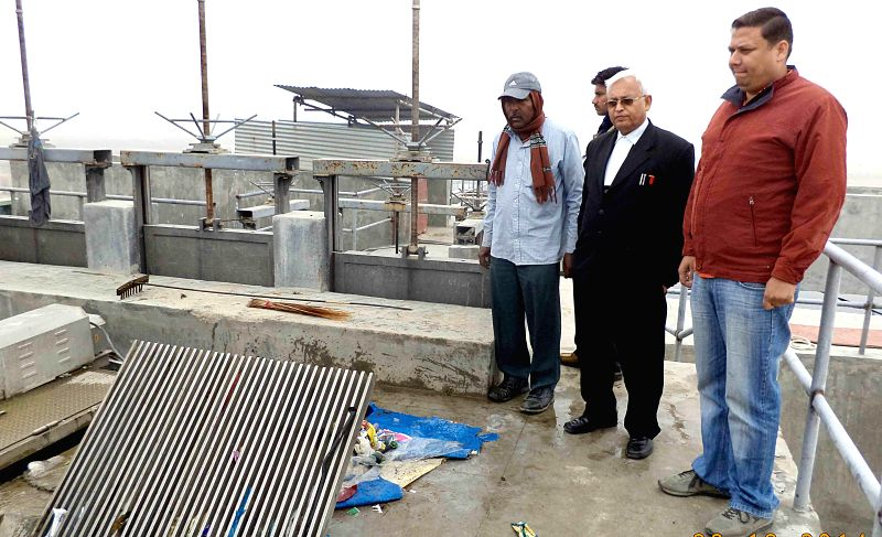 Members of a team headed by amicus curiae Arun Kumar Gupta visits a sewage treatment plant from where reddish-black particles are flowing into the Ganga river in Allahabad, on Dec 22, ...