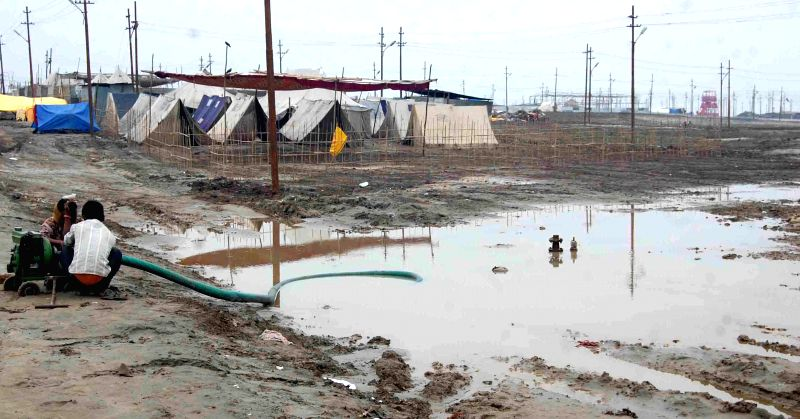 Over night rain disrupts preparations going on for the `Magh Mela` in Allahabad on Jan. 3, 2015.