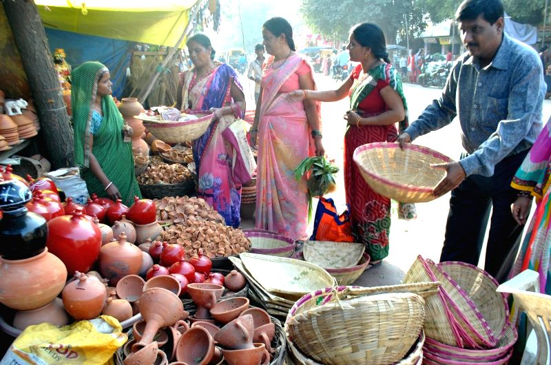 : Allahabad: People busy shopping for the Chhath Puja in Allahabad on Nov 15, 2015. (Photo: IANS).
