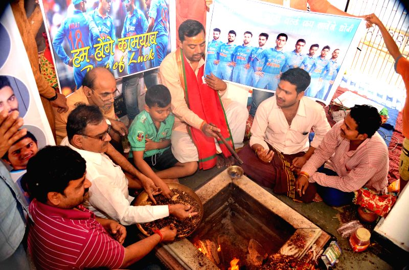 People perform yagna at the Kalyani Devi temple of Allahabad to pray for victory of the Indian cricket team in the ongoing ICC World Cup 2015 on March 25, 2015.