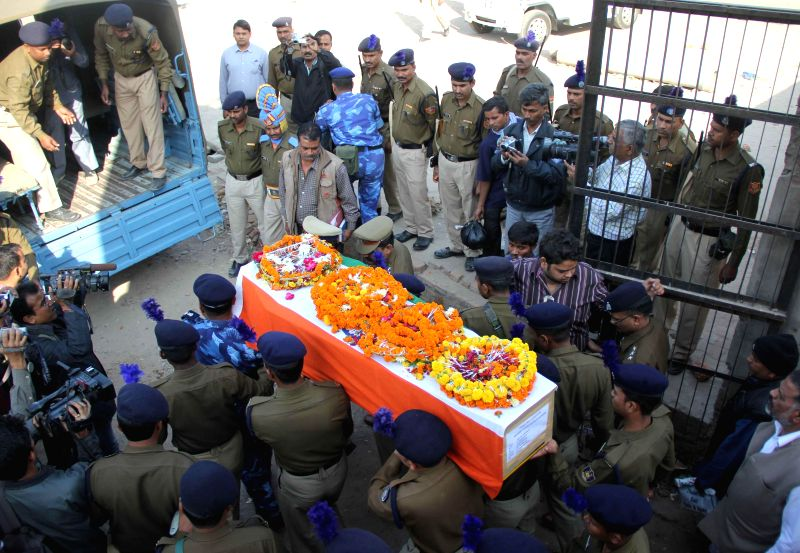 Soldiers take away the body of Mukesh, who was among the 13 CRPF soldiers killed in Dec 1 gun battle with Maoists in Chhattisgarh, for funeral in Allahabad on Dec 3, 2014.