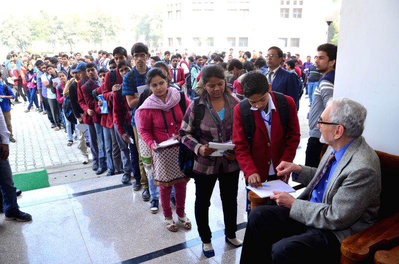The students of the Indian Institute of Information Technology, Allahabad queue-up to get the autograph of  Nobel prize winner Prof Robert Curl at the ongoing Science Conclave in the ...