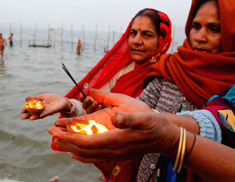 Women perform aarti at Sangam in Allahabad as a month long Magh mela commences on Jan 5, 2015.