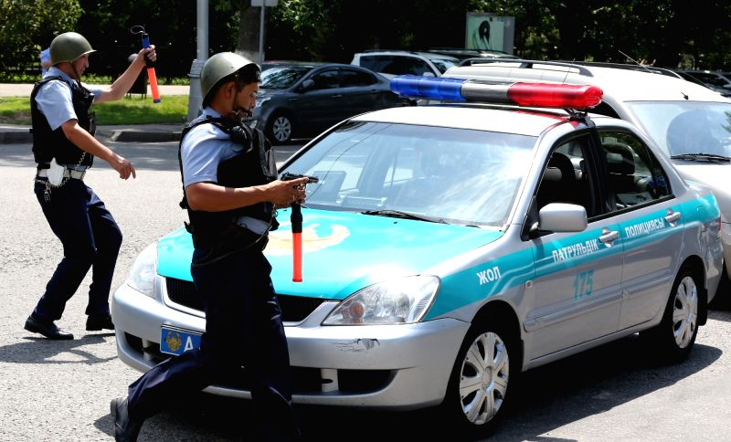 ALMATY, July 18, 2016 - Police officers stand guard at a scene of shooting on the street in Almaty, Kazakhstan, July 18, 2016. Several armed men opened fire towards pedestrians in the street in the ...