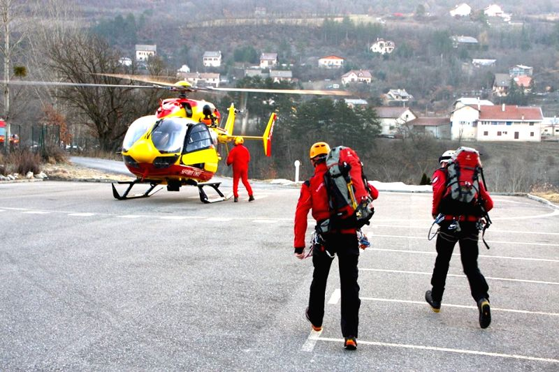 ALPES-DE-French emergency services workers prepare to head for the site where a Germanwings Airbus A320 crashed in Alpes-de-Haute province of France, March 24, 2015. ...