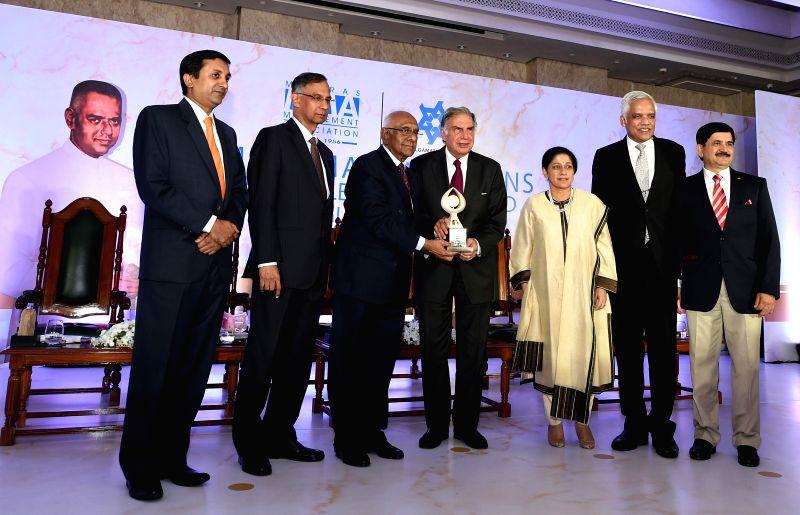 Amalgamations Group Chairman A Krishnamoorthy presents the 18th MMA Amalgamations Business Leadership Award (BLA) 2014 to Tata group Chairman Emeritus Ratan Tata in Chennai on Aug 12, 2014. - Ratan Tata
