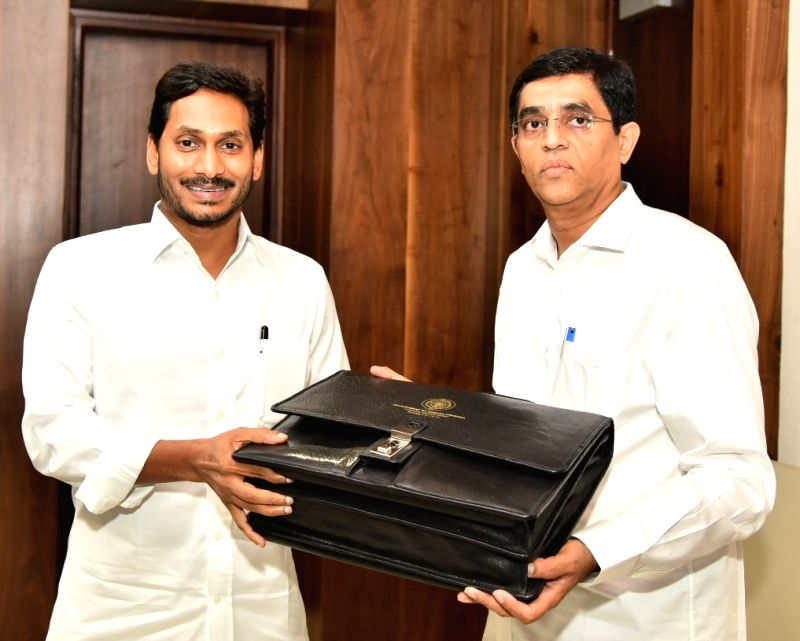 Amaravati: Andhra Pradesh Finance Minister Buggana Rajendranath with Chief Minister Y.S. Jagan Mohan Reddy ahead of the presentation of the annual state Budget 2019-20, in Amaravati on July 12, 2019. (Photo: IANS)