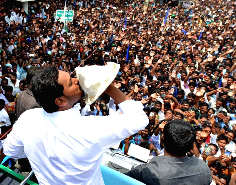 Amaravati: YSR Congress Party (YSRCP) chief Jagan Mohan Reddy blows a conch as he celebrates with party workers after the YSRCP emerged victorious in the Andhra Pradesh Assembly elections in Amaravati, on May 23, 2019. He will take oath as the new Ch