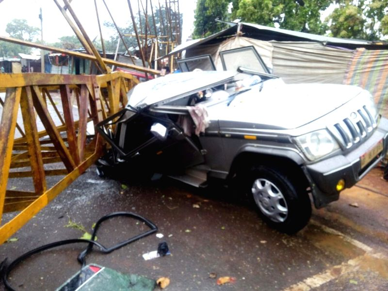The car that got crushed under a crane that collapsed in Amarkantak town of Madhya Pradesh on April 8, 2015. Reportedly three people were killed and four feared dead in the accident that ...