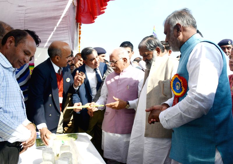 Haryana Chief Minister Manohar Lal Khattar at a stall put up in the exhibition organized on the occasion of `State Level Sahkari Diwas Samaroh` at Ambala, Haryana on Nov. 20, 2014.