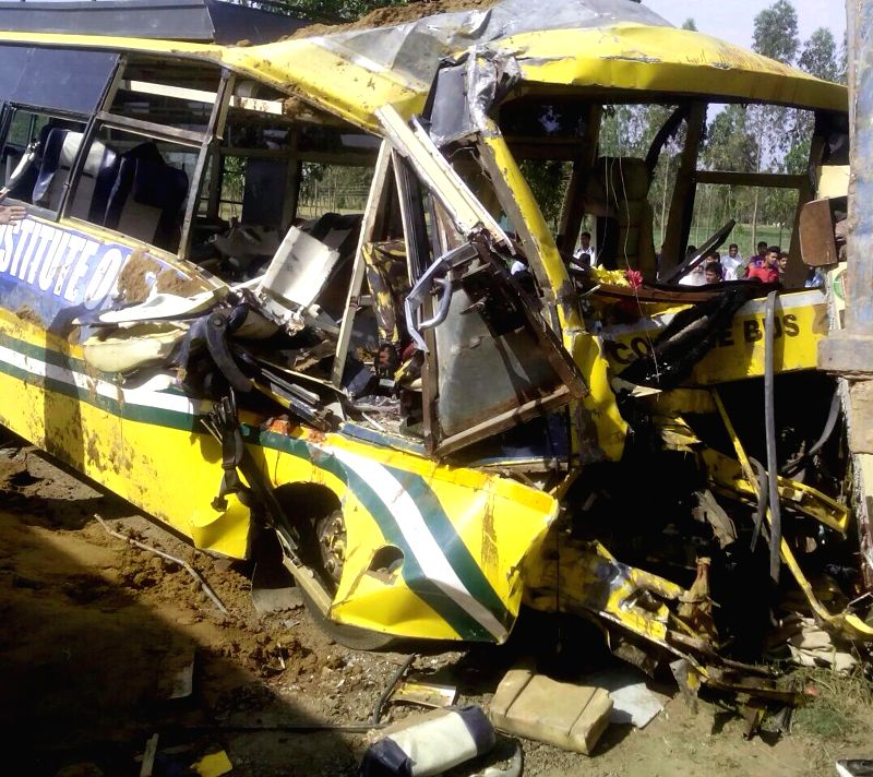 The mangled remains of a college bus that met with an accident near Saha-Shahzadpur road in Ambala district of Haryana, on March 31, 2015. Five lecturers and two students of a private ...